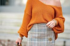 With orange one shoulder loose sweater, brown leather tote bag and high boots