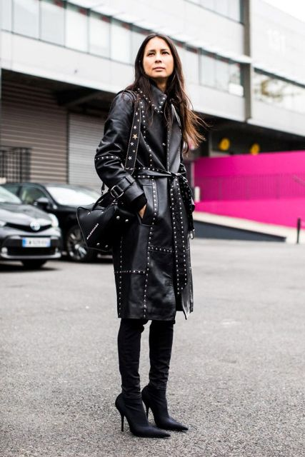 With over the knee boots and black bag