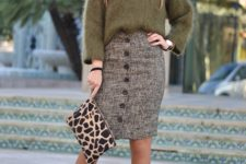 With oversized sweater, leopard clutch and black pumps
