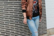 With printed t-shirt, cuffed jeans and black boots