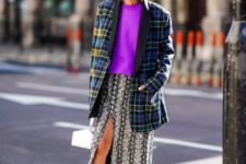 With purple loose sweatshirt, white bag, printed midi skirt and purple pumps