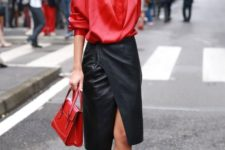 With red loose shirt, red small bag and lace up high heels