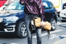 With skinny jeans, pumps and beige leather bag