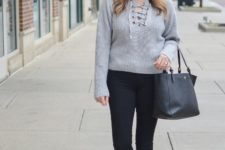 With skinny pants, black tote bag and flat shoes