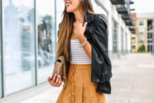 With striped shirt, black leather jacket, beige chain strap bag and black over the knee boots
