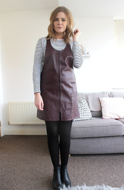 With striped shirt, black tights and black low heeled boots