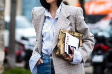 With striped shirt, high-waisted jeans and floral clutch
