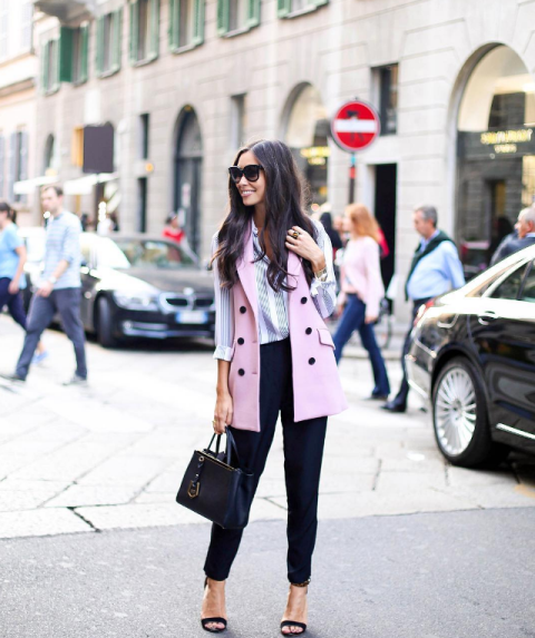 With striped shirt, navy blue trousers, high heels and navy blue leather bag
