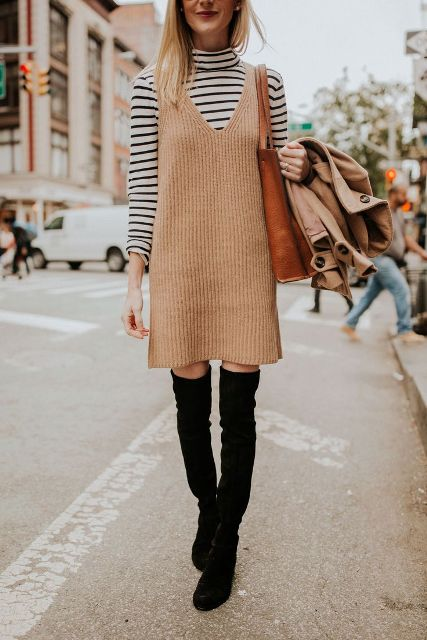 With striped turtleneck, black over the knee boots and brown tote bag