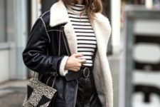 With striped turtleneck, wide brim hat, over the knee boots, printed bag and leather jacket