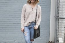 With super distressed jeans, black bag and black mules