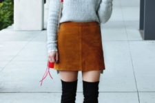 With sweater, brown suede mini skirt, red bag and black over the knee boots