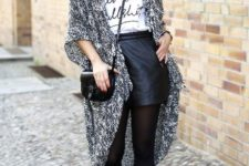 With t-shirt, black crossbody bag, black mini skirt and ankle boots