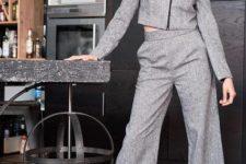 With tweed cropped jacket and black high heels