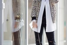 With white blouse, black cropped pants, silver bag and heels