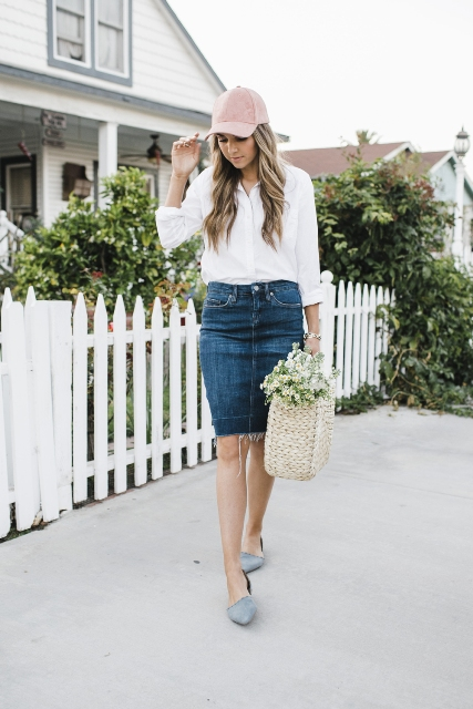 With white button down shirt, denim skirt, suede flat shoes and tote bag