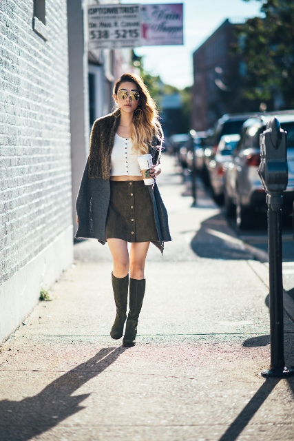 With white cropped top, oversized scarf and high boots