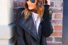 With white long t-shirt, black leather jacket and jeans