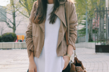 With white loose blouse, distressed jeans and brown suede bag