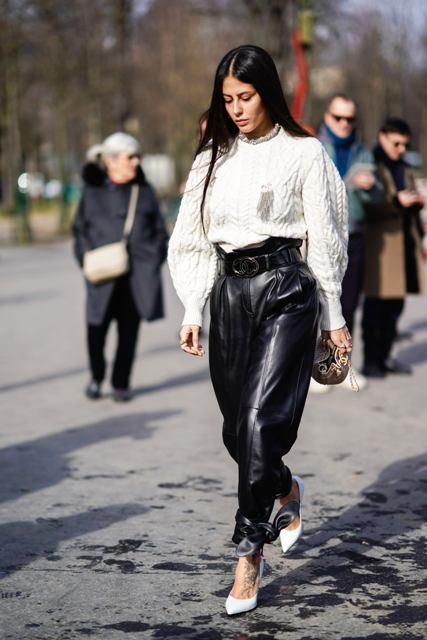 With white oversized sweater, clutch and white pumps