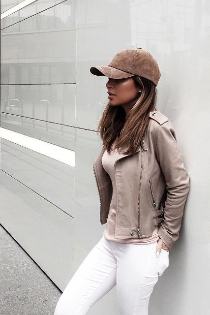 With white pants, beige shirt and beige leather jacket
