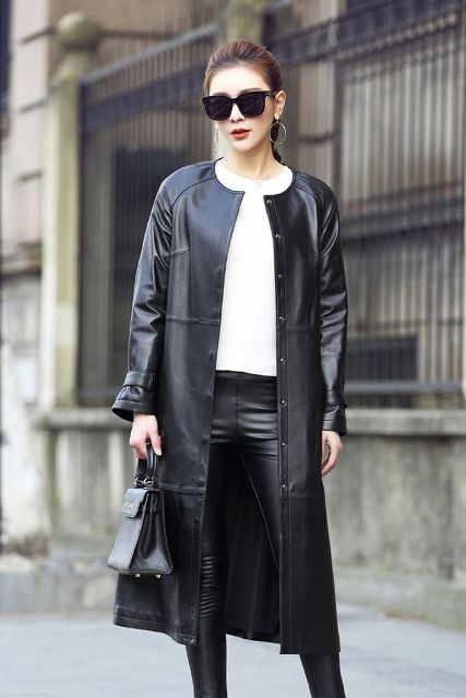 With white shirt, black leather pants and black small bag