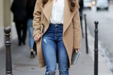 With white shirt, distressed jeans, lace up high heels and beige knee-length coat