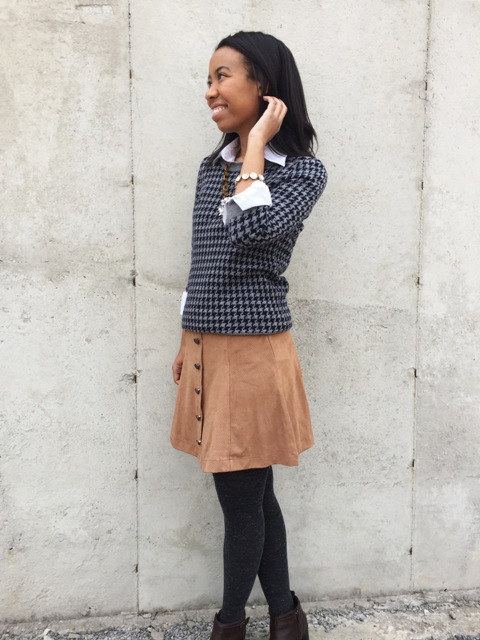 With white shirt, printed shirt, gray tights and boots