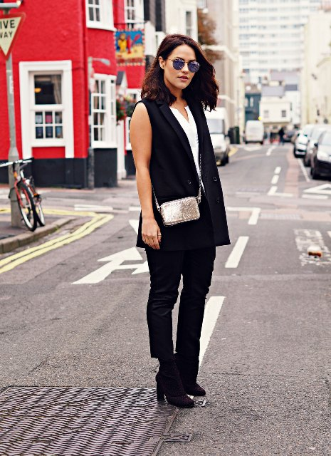 With white shirt, silver mini bag, black pants and black ankle boots