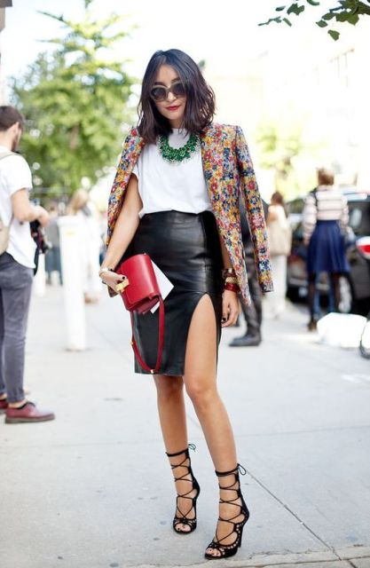 With white t-shirt, green necklace, printed blazer, black lace up shoes and red leather clutch