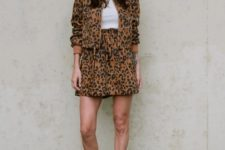 With white t-shirt, leopard skirt and lace up boots