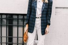 With white t-shirt, white pants, brown clutch and black lace up flat boots