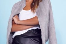 With white top and black leather high-waisted skirt