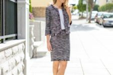 With white top, black pumps and tweed jacket