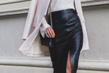 With white turtleneck, chain strap bag, white long blazer and cutout boots