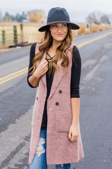 With wide brim hat, black shirt and distressed jeans
