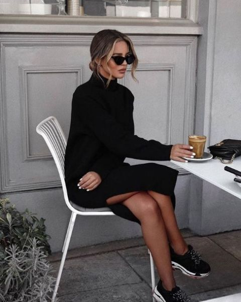 a black knit midi dress with a side slit, blakc trainers will make up a cool casual winter look