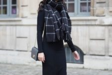 a black knit midi dress with long sleeves, white sneakers, a black and white scarf and a black bag