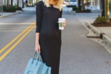 a black midi dress with high neckline and long sleeves, white sneakers and a blue bag for this fall and winter