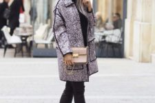 a black turtleneck, black leather pants, grey studded shes and a pink printed coat plus a grey box bag