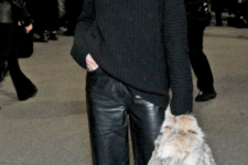 a black chunky knit sweater, black leather culottes, snake print shoes and a faux fur coat