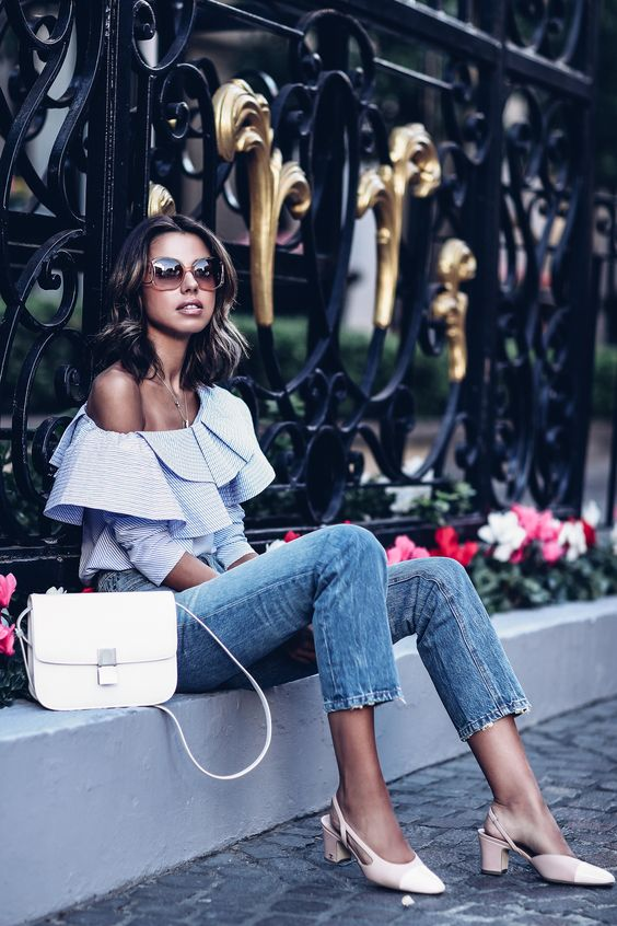 a blue ruffle on shoulder top, blue jeans, blush slingbacks and a white Classic Box bag