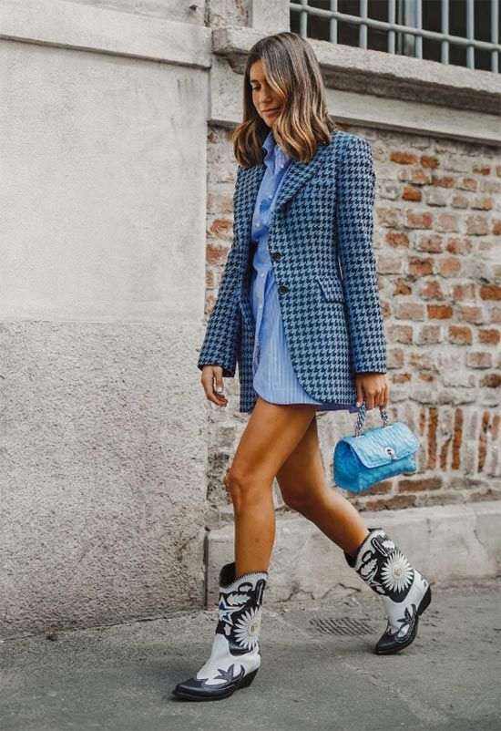 a blue shirtdress, a printed vintage-inspired blazer, black and white cowboy boots and a small blue bag