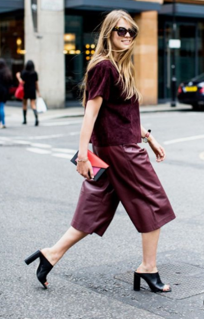 a bright and trendy fall look with burgundy leather culottes, a velvet top with short sleeves and black shoes
