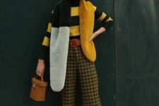a bright look with a striped yellow and black turtleneck, plaid pants, silver shoes and a shawl that matches