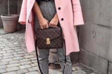 a bright outfit with a printed tee, printed cropped pants, white sneakers, a pink coat and a brown box bag