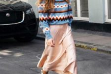 a bright printed sweater, a blush midi skirt and white cowboy boots for a statement look