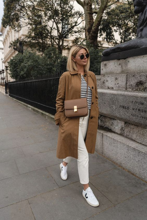 a casual outfit with white jeans, sneakers, a striped tee and a camel trench is finished with a camel Classic Box