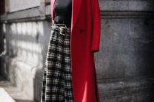 a chic outfit with a blakc turtleneck, plaid culottes, black shoes and a red coat is style and classics