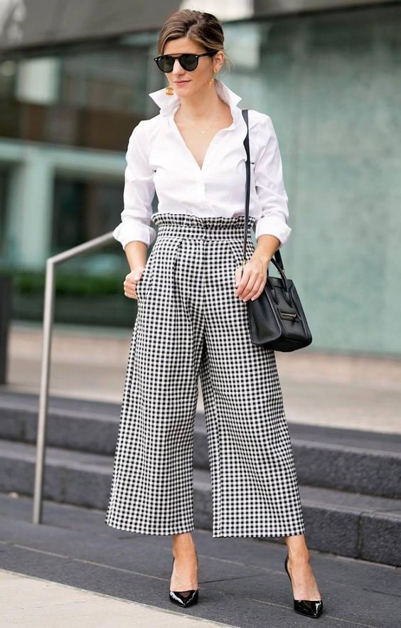 a classic monochromatic work outfit with a white shirt, plaid cropped pants, black heels and a black bag